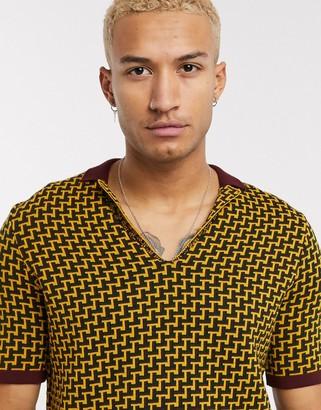 ASOS DESIGN muscle fit polo shirt with geo design in mustard