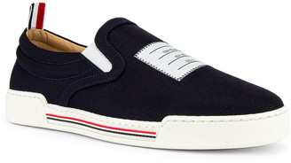 Thom Browne Slip On Sneaker in Navy   FWRD