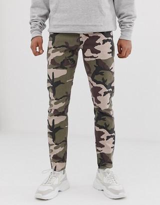 ASOS DESIGN slim jeans in camo print