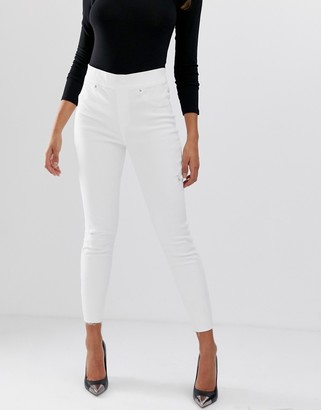 Spanx shape and lift distressed skinny jeans
