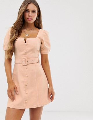 Asos Design DESIGN denim puff sleeve mini dress with belt and buttons in peach-Pink