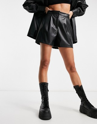 ASOS DESIGN leather look suit shorts in black