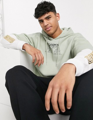 ASOS DESIGN double layer hoodie in green with sleeve print