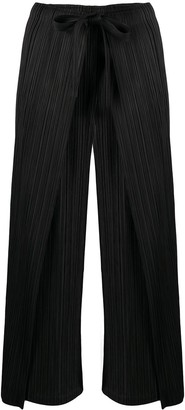 Pleats Please Issey Miyake high-rise pleated wide-leg trousers