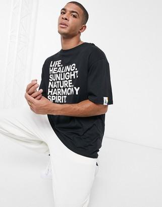 Reebok Pride T-shirt with UV-reactive ink print in black