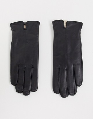 Accessorize leather gloves with faux fur lining in black