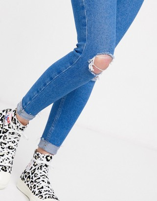 New Look skinny jeans with knee rips in blue