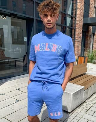 ASOS DESIGN co-ord jersey skinny shorts with Malibu print