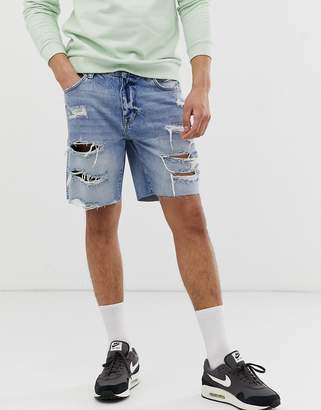 Bershka slim denim shorts with rips in light blue