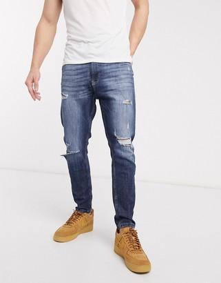 Bershka carrot fit jeans in blue