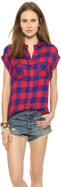 kourtney kardashian  Who made  Kourtney Kardashians red and blue plaid plaid shirt?