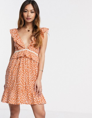 ASOS DESIGN tiered mini sundress with frill lace inserts in ditsy floral print