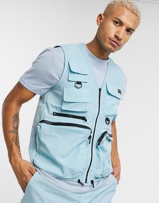 Criminal Damage nylon utility vest co-ord in blue