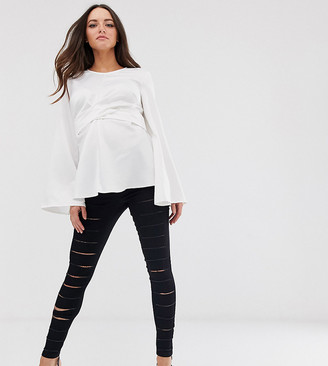ASOS DESIGN Maternity pull on jegging in clean black with slash rip detail and under the bump waistband