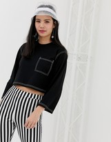 Monki cropped top with contrast stitching in black