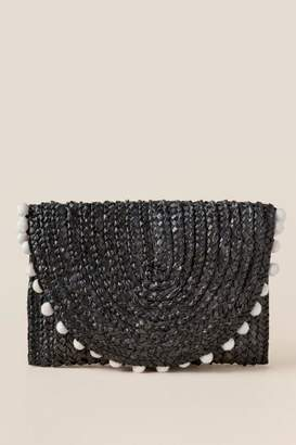 francesca's Reagan Straw Pom Clutch in Black - Black