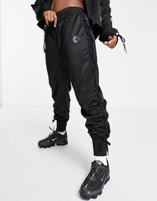 Nike Sisterhood lace-up detail polyknit track pants in black
