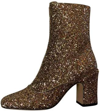 Christian Dior Gold Glitter Ankle boots
