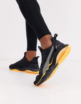 Puma LQDcell tension rave sneakers in black and orange