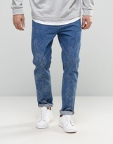 Asos Slim Tapered Jeans In Mid Wash With Random Acid