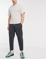 Asos Design DESIGN organic tapered joggers with pleats in charcoal