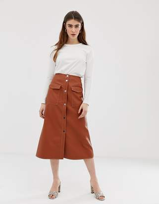 Asos Design DESIGN leather look midi skirt with popper front and statement pockets-Brown