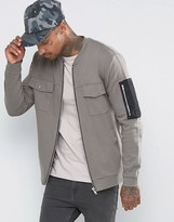 Asos Oversized Jersey Bomber Jacket With Woven MA1 Pocket