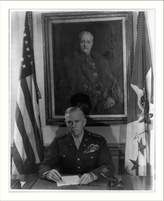 Library Images Historic Print (L): Marshall at his desk in the Pentagon, Nov. 1, 1945; portr. of Pershing hangs in backgrou