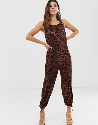ASOS DESIGN plisse tie cuff balloon leg jumpsuit in zebra animal print