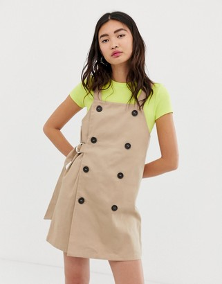 Monki dungaree dress with sided belt in beige-Red