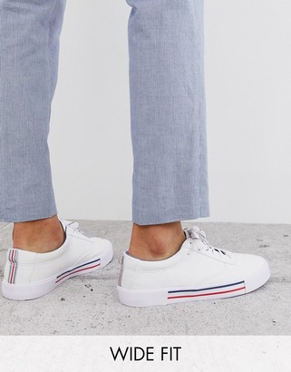 ASOS DESIGN Wide Fit lace up plimsolls in white with navy and red detailing
