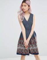 Yumi Belted Skater Dress In Border Print