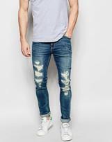 Asos Super Skinny Jeans With Mega Rip And Repair In Mid Blue