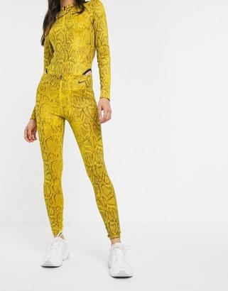 Nike yellow snake print high waist leggings