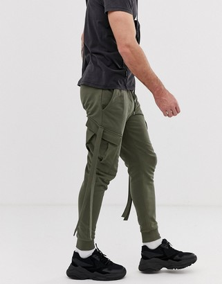 Asos Design DESIGN skinny joggers with cargo pockets and strapping in khaki-Green