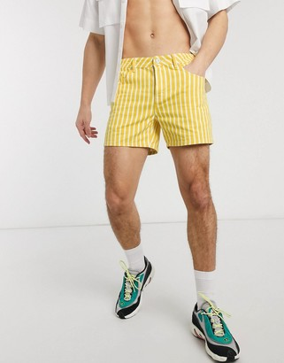 ASOS DESIGN slim short in yellow and white stripe in shorter length