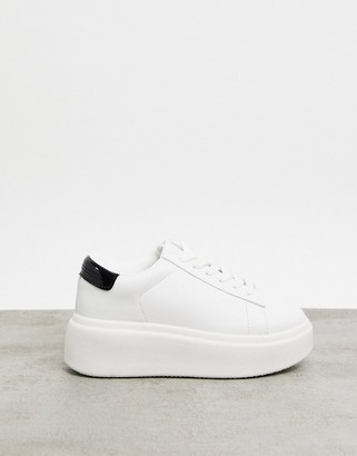 Truffle Collection flatform trainers in white with black tab