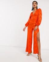 Asos Design DESIGN satin jumpsuit with blouson sleeve in orange floral jacquard