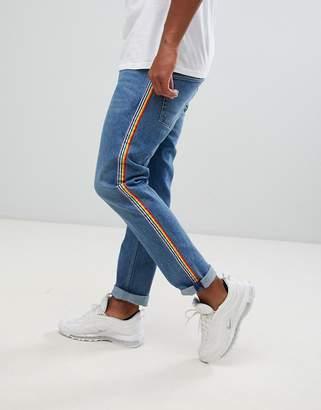 Asos Design DESIGN slim jeans in mid wash blue with rainbow stripe