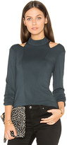 Krisa Cutout Turtleneck Top in Teal. - size XS (also in )
