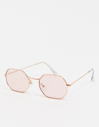 ASOS DESIGN metal hexagon shaped sunglasses in rose gold with pink lens