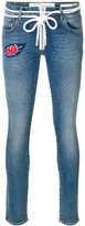 Off-White diagonals print jeans