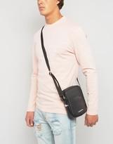 Lacoste Leather Look Flight Bag In Black