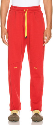 Pyer Moss College Slouch Pant in Red   FWRD