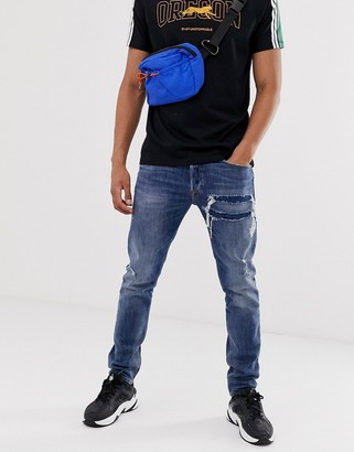 Diesel Tepphar X slim carrot fit rip and repair jeans in 0890X mid wash