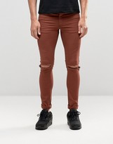 Asos Extreme Super Skinny Jeans With Knee Rips In Rust