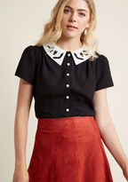 6545 It takes courage to commit to a look as chic as this black blouse by Hell Bunny! The ivory collar - embroidered with a cloud of bats - and pearly buttons of this short-sleeved top look hauntingly haute alongside the audacious attitude you always wear.