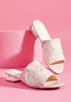 SB-Ryder When it comes to these blush pink slides from Betsey Johnson, luxurious detail is in no short supply. Delicate lace amplified by abstract floral embroidery and matte silver sequins cover the uppers of these marvelous mules, as their lucite block heels pro