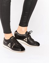 Le Coq Sportif Black And Gold Wendon Sneakers