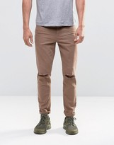 Asos Skinny Jeans With Knee Rips In Brown